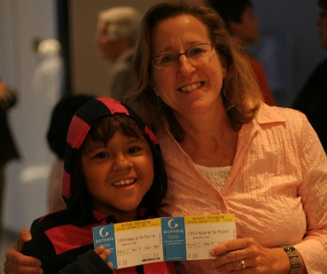 Family with Project Success tickets to the theater