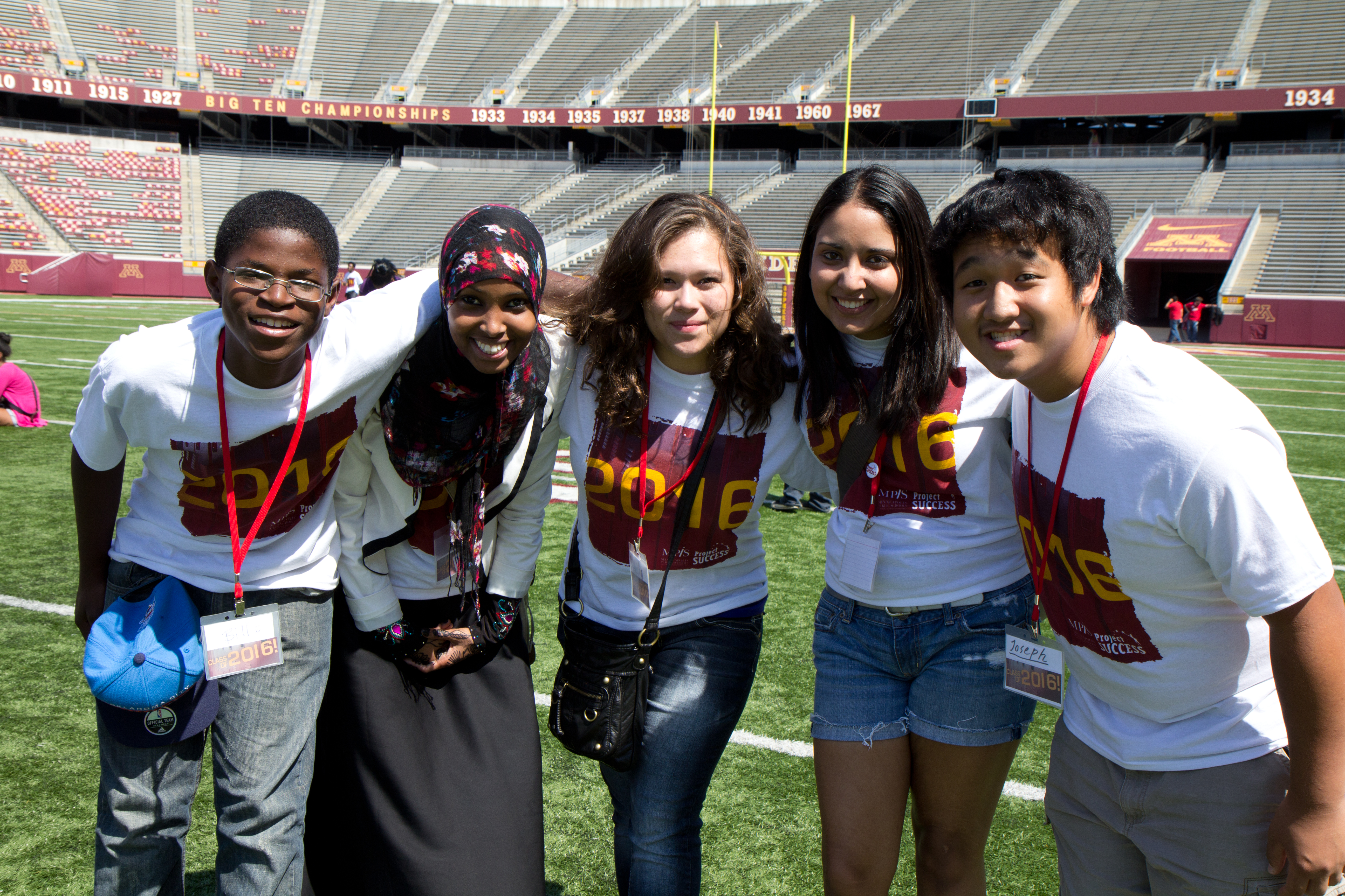 Five Project Success students at an event